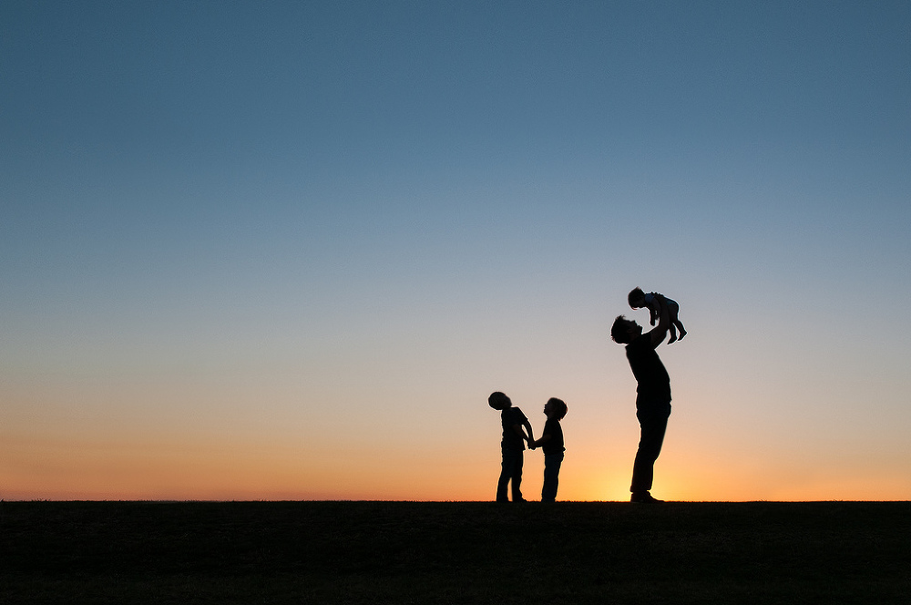 silhouette of father/dad with three children in hill from ericamontgomeryphotography.com